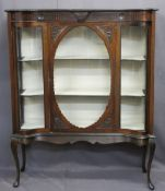 EDWARDIAN MAHOGANY DISPLAY CABINET with serpentine glass front panels flanking a cameo framed door