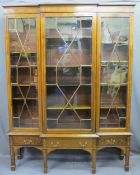 EDWARDIAN SHERATON STYLE INLAID BREAKFRONT BOOKCASE/CABINET having three lower drawers on square
