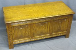 JAYCEE REPRODUCTION OAK LIDDED BLANKET CHEST with linenfold front detail, 51cms H, 105.5cms W, 46.