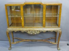 CHIPPENDALE STYLE WALNUT DISPLAY CABINET ON STAND having three opening doors and interior glass