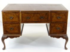 GEORGE II-STYLE BURR WALNUT & MAHOGANY CROSSBANDED KNEEHOLE DESK, red leather inset top above
