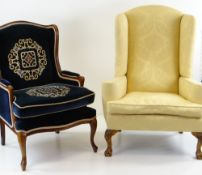 TWO WINGBACK ARMCHAIRS, comprising a George II style armchair upholstered in yellow floral damask