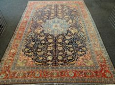 KASHAN CARPET, central Persia, 20th Century, central pale blue medallion on an indigo palmette and
