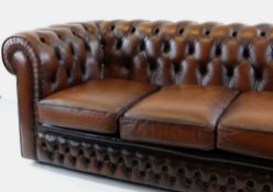 VICTORIAN-STYLE BROWN LEATHER CHESTERFIELD SOFA, button-upholstered with loose cushions, 183 x 92