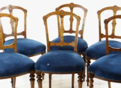 SET OF SIX LATE VICTORIAN WALNUT DINING CHAIRS, with engraved open backs, shaped stuffover seats