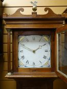 EARLY 19TH CENTURY MAHOGANY 30-HOUR LONGCASE CLOCK, square hood with scrolled pediment and brass