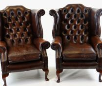 PAIR GEORGIAN-STYLE BROWN LEATHER WINGBACK ARMCHAIRS, by Whittle Bros. of Warrington, button-