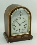 WINTERHALDER & HOFFMEISTER MANTEL CLOCK, mahogany and boxwood strung arched case with strike/
