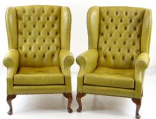 PAIR GEORGIAN-STYLE WINGBACK ARMCHAIRS, button upholstered in mustard leather (faded) (2) COLLECTING