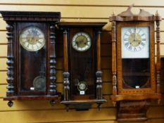 THREE 20TH CENTURY WALNUT WALL CLOCKS including an American parquetry clock with floral base,