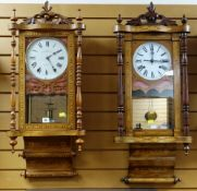 TWO AMERICAN WALNUT MARQUETRY DROP DIAL WALL CLOCKS, with 8 inch roman white enamel dials, turned