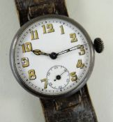 LARGE WWI PERIOD WRISTWATCH, white enamel dial with roman numerals, subsidiary seconds and cathedral