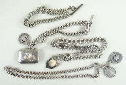 THREE SILVER CURB LINK ALBERT CHAINS, with swivel hooks, fobs, a vesta case and a 1887 shilling,