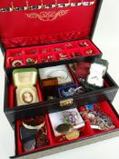 ASSORTED COSTUME JEWELLERY comprising brooches, earrings ETC in a folding black leather jewellery