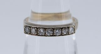YELLOW METAL SEVEN-STONE DIAMOND RING totaling 0.28cts overall approximately (visual estimate), size
