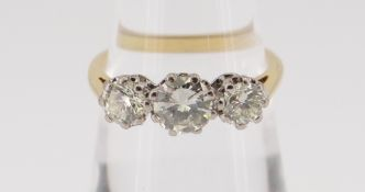 18CT GOLD THREE-STONE DIAMOND RING, the three claw set stones totalling 1.0cts approximately (visual