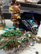 SMALL GROUP OF ASSORTED COSTUME JEWELLERY including copper bangles on a stand, stone necklaces,