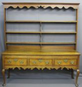 SHROPSHIRE OAK DRESSER, open back with four shelves, carved detail to upper frieze railback, three
