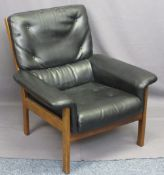 MID-CENTURY TEAK FRAMED ARMCHAIR, upholstered in black with button and stitch detail bearing 'Pelham