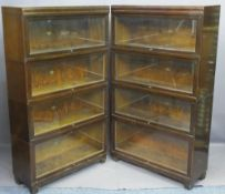 OAK GLOBE-WERNICKE BOOKCASES, a pair, graduated four section with lift-up glazed doors, 146cms H,