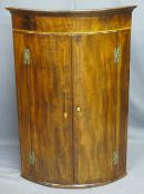 BOW FRONT MAHOGANY WALL HANGING CORNER CUPBOARD, twin door, string inlay 'H' bracket hinges with
