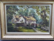 EDWARDIAN OIL ON CANVAS - a cottage with figure, 34 x 54cms