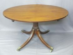 REGENCY MAHOGANY OVAL BREAKFAST TABLE turned column, splayed supports on castors, 70cms H, 123cms W,