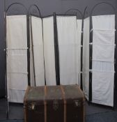 WOODEN BANDED TRAVEL TRUNK and three tri-fold metal and canvas screens, 188cms H, 126cms W the
