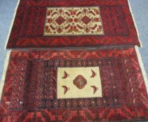 EASTERN STYLE WOOLLEN CARPETS (2) both red ground, similarly bordered, both with central bird