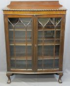 VINTAGE MAHOGANY TWO-DOOR DISPLAY CABINET on ball and claw feet, 126cms max H, 91cms W, 35cms D