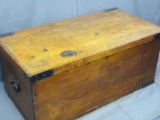 ANTIQUE PINE LIDDED STORAGE BOX with iron carry handles and corner straps, 48cms H, 110cms W,