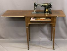VINTAGE SINGER ELECTRIC SEWING MACHINE in a mahogany worktable, 83cms H, 64cms W, 45cms D