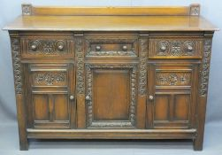 QUALITY CARVED OAK RAILBACK SIDEBOARD having three frieze drawers and lower cupboard doors on