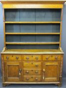 NORTH WALES OAK DRESSER with three shelf rack over three drawers, two base cupboards with three