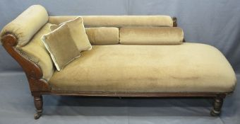 ANTIQUE CHAISE LONGUE upholstered in brown with stud detail, scroll and floral carvings on turned