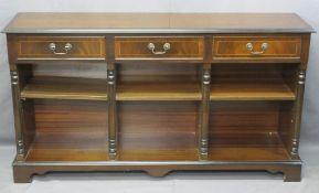 REPRODUCTION MAHOGANY BOOKCASE having three frieze drawers and a sectional base with adjustable