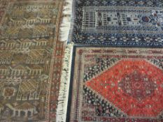 EASTERN WOOLLEN CARPETS (3) including a vintage red ground example with repeated central block