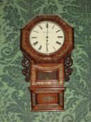 A FINE ROSEWOOD & MOTHER OF PEARL INLAID PENDULUM WALL CLOCK, the circular dial set in an