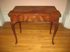 ROSEWOOD GAMES TABLE - with finely grained foldover top having a folding base on cabriole