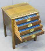 VINTAGE OAK FOUR DRAWER COIN COLLECTOR'S CABINET, the drop-down front opening to reveal four glass
