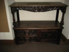 LATE 19TH CENTURY CARVED OAK BUFFET SIDEBOARD, the upper shelf having a carved and scrolled apron