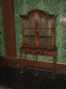WALNUT DISPLAY CABINET, one piece of neat proportions, the top having a domed hood with twin