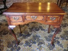 ANTIQUE CROSSBANDED MAHOGANY & WALNUT LOWBOY, the rectangular moulded edge top over three frieze