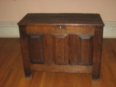 AN 18TH CENTURY SMALL OAK COFFER, the triple plank top over three fielded front panels, 105cms W