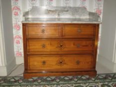 AN EDWARDIAN PINE WASHSTAND with white marble back and side rail top with small oval half-moon shelf
