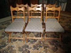 SET OF 6 GOTHIC STYLE SALON/DINING CHAIRS having rose roundels carved to the crest and central