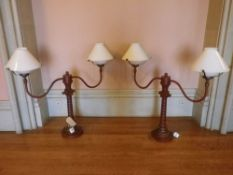 REPRODUCTION SCUMBLED METAL TWIN BRANCH LAMPS in the form of vintage wig stands with white glass