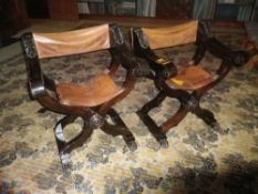 CONTINENTAL CARVED & STAINED WALNUT X FRAME CAMPAIGN TYPE FOLDING CHAIRS with leather seats and