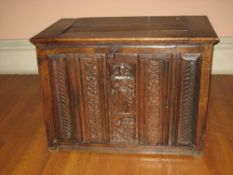 LATE 18TH CENTURY OAK COFFER having an inset lid to the top and with four narrow carved panels and a