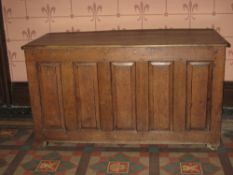 LATE 18TH CENTURY OAK DOWER CHEST having a four panel lid over a base having five narrow fielded
